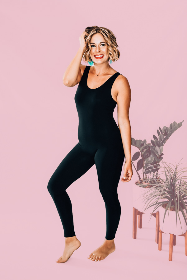 "BLACK SLEEVELESS SCOOP NECK UNITARD. 94% COTTON, 6% SPANDEX. PIPER IS 5'4"", SIZE 0, WEARING A SMALL. AMANDA IS SIZE 2 WEARING A SMALL. XS 0-2 S 4-6 M 8-10 L 10-12 XL 12-14"