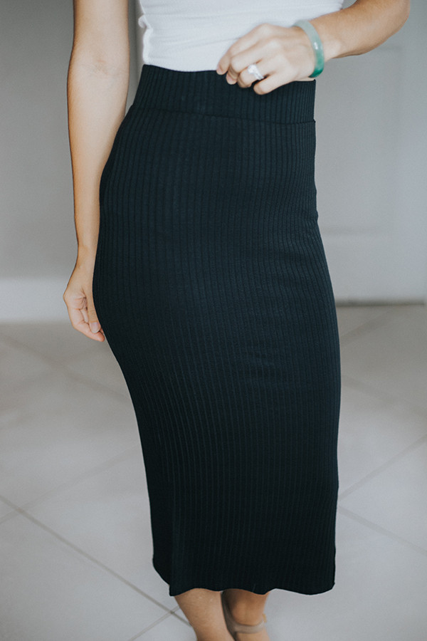 HIGH WAISTED CALF LENGTH RIBBED SKIRT  WITH EYELET SIDE SEAM 95% RAYON  5% LYCRA AVAILABLE IN OLIVE AND CHARCOAL.  SMALL 4-8  MEDIUM 10-12   LARGE 14-16