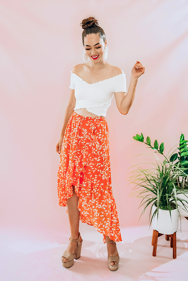 100% polyester, ruffled maxi skirt, double lined. Elastic waist and tie on the front. Piper is 5'4 , size 0 wearing a Small.  S 0-4 M 4-8 L 8-12