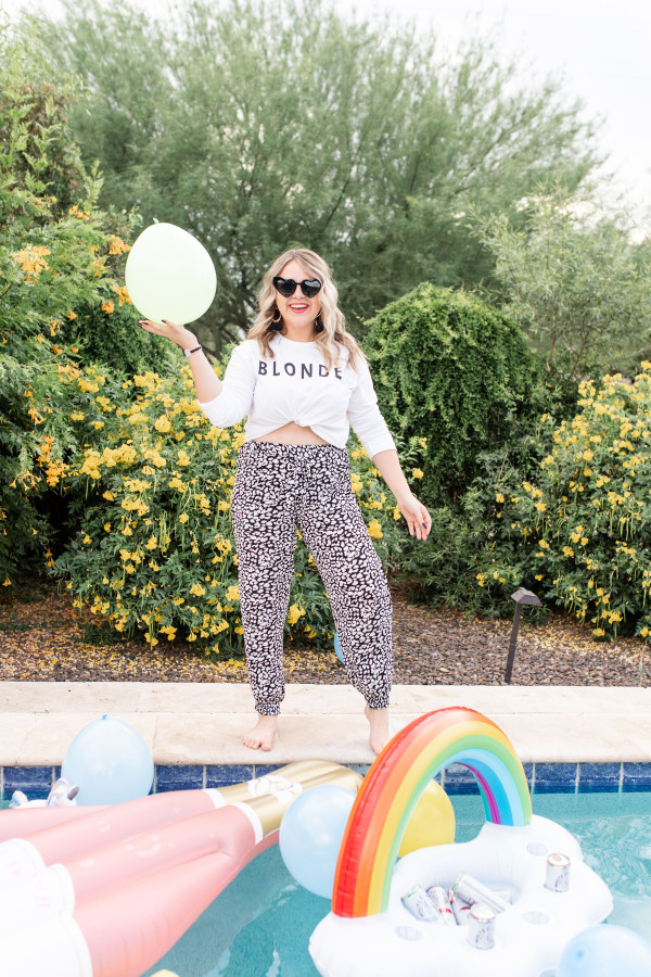 """""""BLONDE"""" WHITE CROPPED, LONG SLEEVE GRAPHIC TEE. DROPPED SHOULDER AND RIPPED CUFF. 100% COTTON. KATIE IS A SIZE 6, WEARING A MEDIUM.  S 0-4 M 4-8 L  8 -12"""