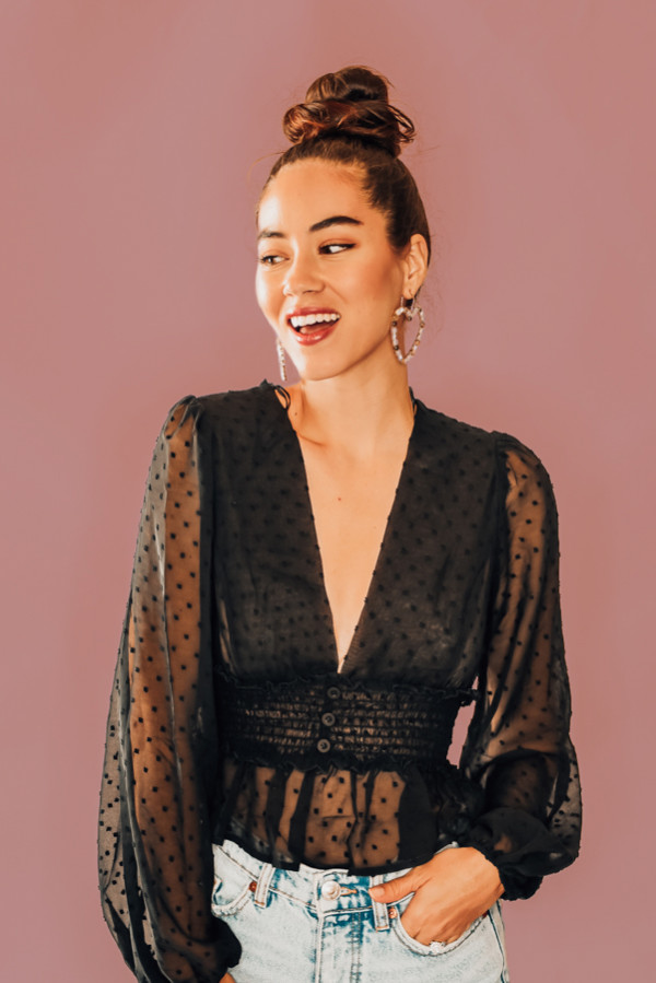 BLACK, POLKA DOT, SHEER PLUNGE BLOUSE. CROPPED, RUFFLE BOTTOM, CINCHED SLEEVES, RUCHING, FAUX BUTTON MID SECTION. COMES IN TWO COLORS, BLACK & TAN. 100% POLYESTER. PIPER IS 5'4 SIZE 0, WEARING SMALL. STEPHANIE IS SIZE 4, WEARING SMALL. S 0-4 M 4-8 L 8-12
