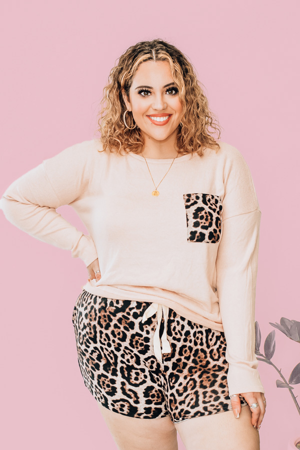 LONG SLEEVE FLEECE TOP AND SHORTS. NUDE COLOR TOP WITH LEOPARD POCKET DETAIL. LEOPARD SHORTS WITH ELASTIC WAIST AND NONFUNCTIONAL TIE. 77% RAYON 19% POLYESTER 4% SPANDEX. NIKKI IS SIZE 14, WEARING XL. DALLAN IS A SIZE 4, WEARING A SMALL.