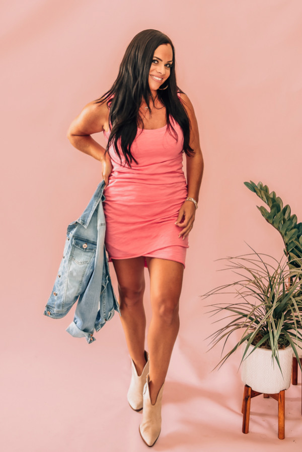 PINK, SLEEVELESS, BODYCON DRESS. SIDE RUCHING, FRONT LAYERED LOOK. 100% COTTON. STEPHANIE IS 5'1 SIZE 4, WEARING SMALL. NIKI IS SIZE 14, WEARING A LARGE. S 0-6 M 6-12 L 12-16