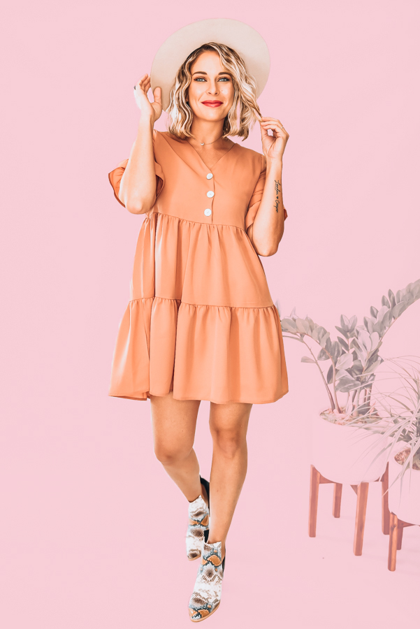 LIGHTWEIGHT MATERIAL FEATURING RUFFLED SLEEVES AND BODY. THREE FUNCTIONAL BUTTONS. CAN BE WORN AS A DRESS OR TUNIC. 100% POLYESTER. STEPHANIE IS 5'1 SIZE 4, WEARING A SMALL. XS 0-2 S 2-4 M 6-8 L 8-10 XL 10-12