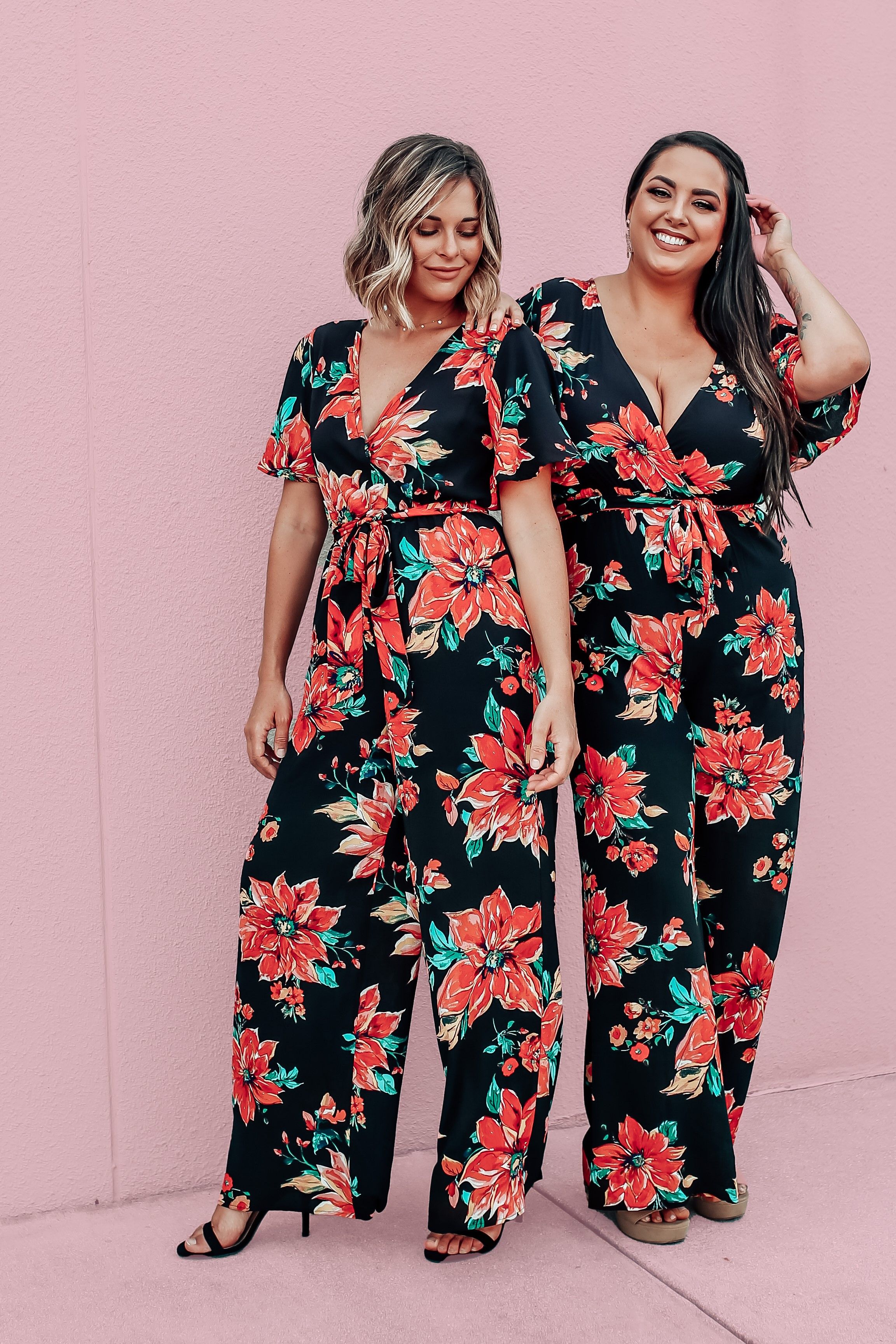 MAVERICK EXCLUSIVE! BLACK BACKGROUND WITH LARGE RED-TONES FLORAL PATTERN. WIDE LEG, ELASTIC WAIST, REMOVABLE TIE. FLOWY SHORT SLEEVES. TWO BUTTON DETAIL ON BACK. 100% POLYESTER.