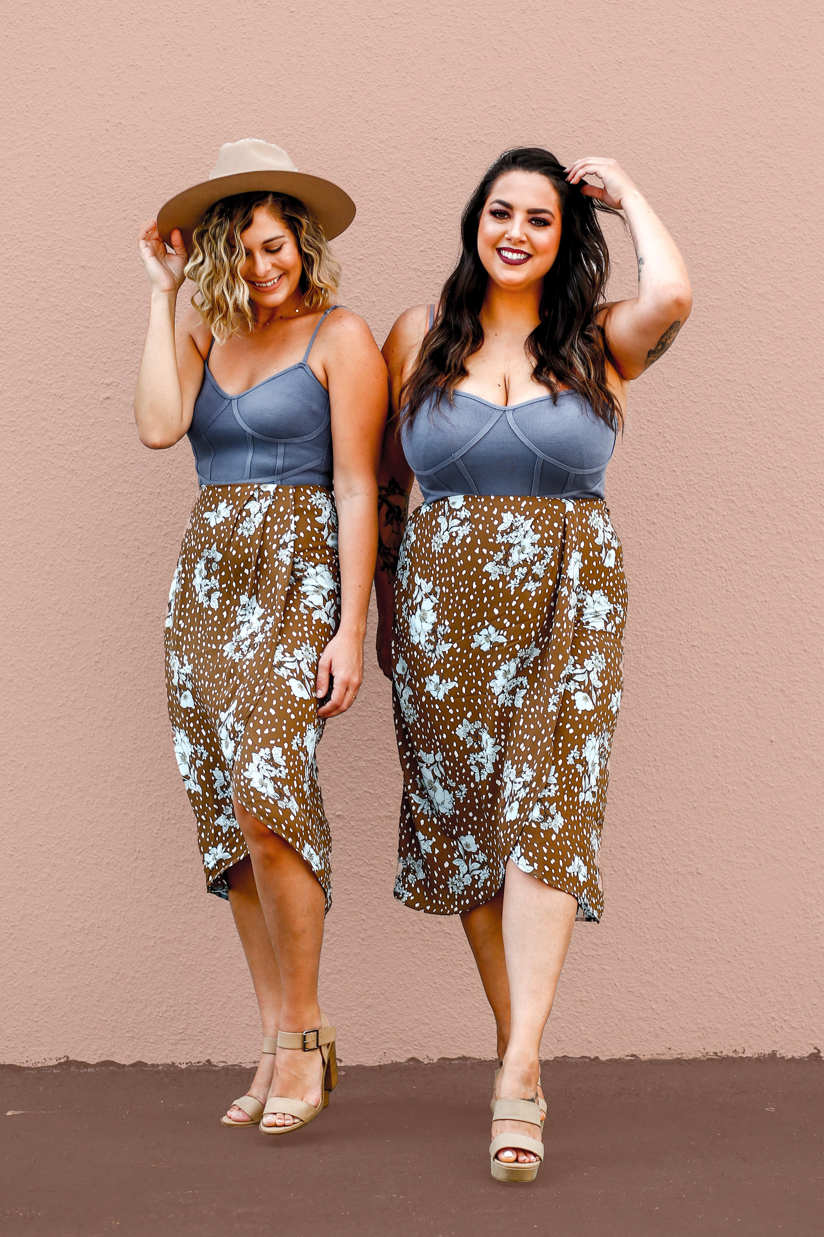 """MAVERICK EXLCUSIVE! SAME FABRIC AS OUR KENT PANTS. FAUX WRAP STYLE SKIRT. MIDI LENGTH. ZIP UP BACK. NO ELASTIC ON WAIST. 100% POLYESTER. STEPHANIE IS 5'4"""" SIZE 4 WEARING A SMALL. XS 0-2 S 4-6 M 8-10 L 10-12 XL 12-14"""