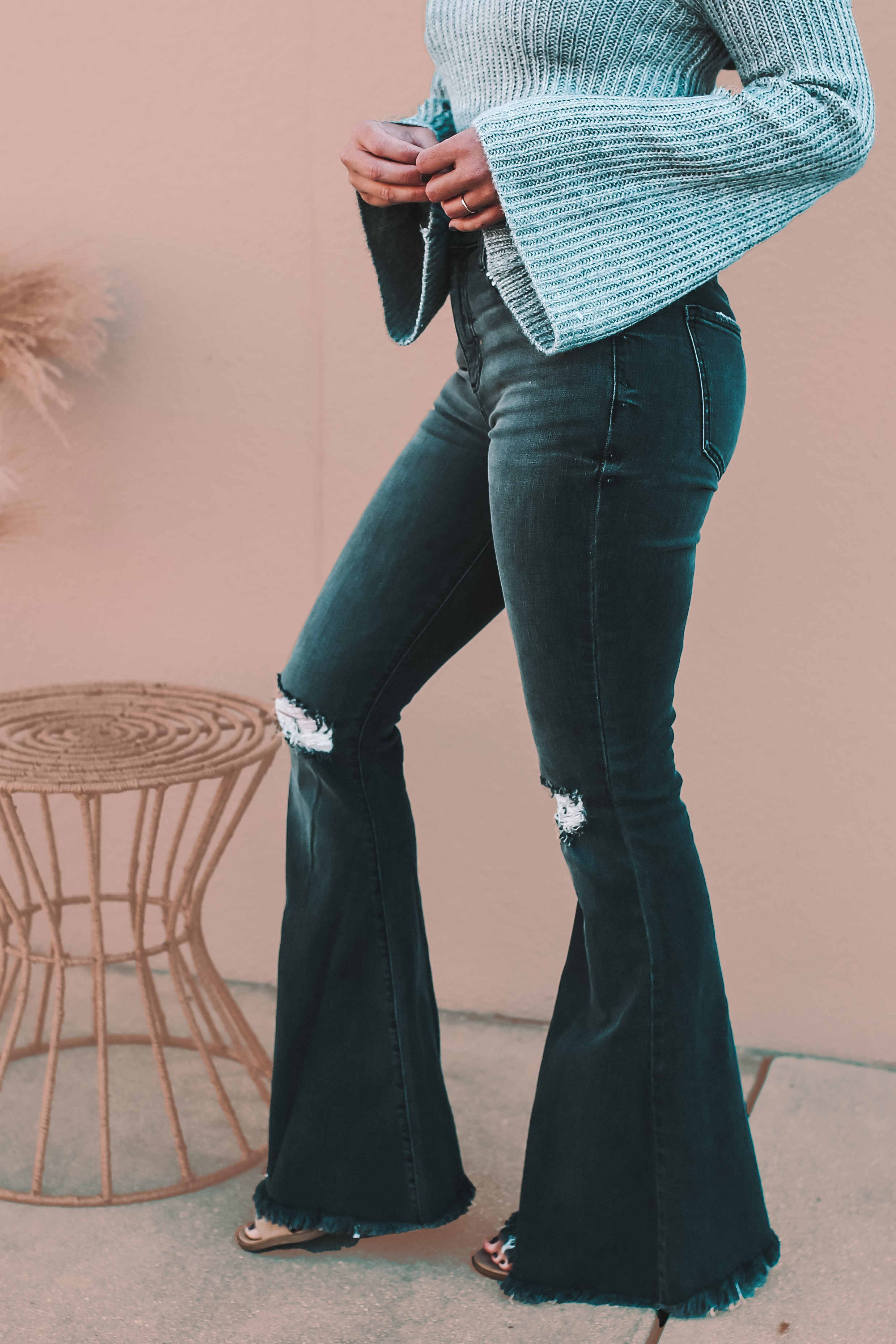"""SAME CUT AS OUR BEST-SELLING WHITE BELL BOTTOMS! HIGH RISE, BLACK WASH PREMIUM DENIM. VERY SOFT AND STRETCHY. DISTRESSED KNEES AND HEM. INSEAM: 33"""" FOR ALL SIZES. 73% COTTON 14% RAYON 11% POLYESTER 2% SPANDEX."""