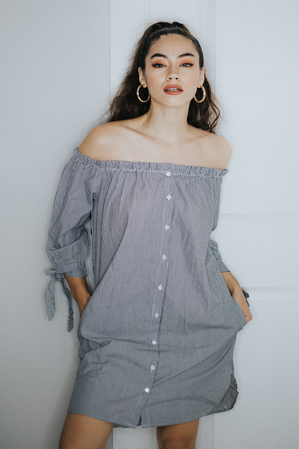 PIN STRIPE OFF THE SHOULDER DRESS. NANTUCKET VIBES WITH THIS AMAZING DRESS. BUTTONS ALL THE DOWN AND ELASTIC AROUND THE NECKLINE TO ENSURE THE DRESS STAYS IN PLACE OFF THE SHOULDERS.