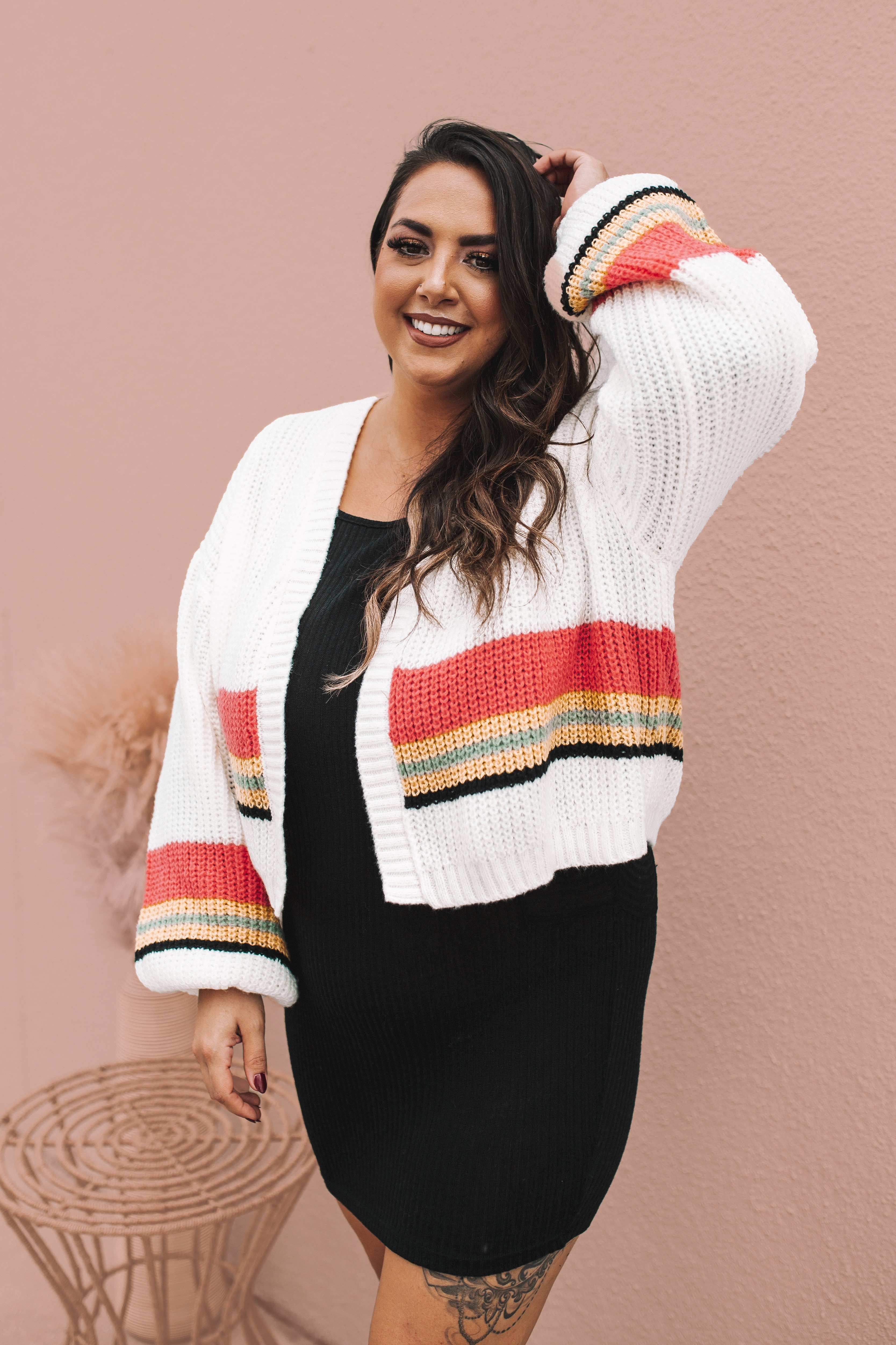 CREAM COLORED CHUNKY KNIT CARDIGAN WITH BUBBLE SLEEVES. FEATURING PINK, MUSTARD, GREY AND BLACK STRIPES. 100% POLYESTER. AMANDA IS 5'7 SIZE 2, WEARING A SMALL. GABBY IS SIZE 10/12 WEARING A LARGE. S 0-4 M 6-10 L 12-16