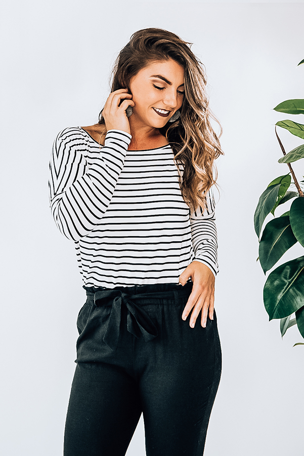 BLACK AND WHITE STRIPE LONG SLEEVE TOP. LOOSE FITTING WITH DROP SHOULDER DETAIL. SISSY IS A SIZE 6 AND WEARING A SMALL. NIKI IS A SIZE 14 AND WEARING A LARGE. 95% POLYESTER 5% SPANDEX  X-SMALL 0-2 SMALL 4-6 MEDIUM 8-10 LARGE 12-14 X-LARGE 16-18