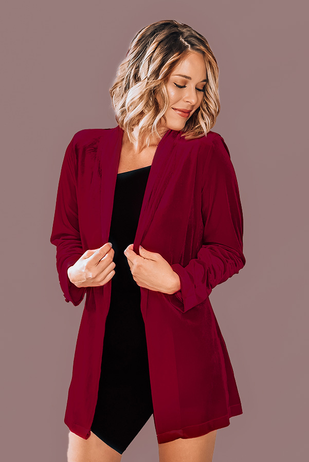 """VELVET BLAZER. RED COLOR WITH BUTTON DETAIL ON SLEEVES. 95% POLYESTER, 5% SPANDEX. AMANDA IS A SIZE 5'6"""" SIZE 2, WEARING A SMALL.  S 0-4 M 6-10 L 10-14"""