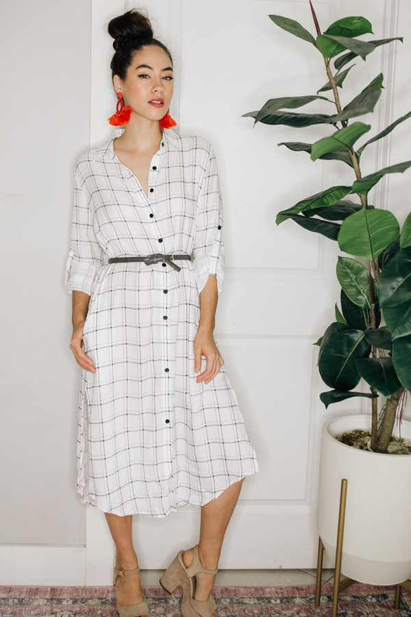 BUTTON UP PLAID DRESS WITH CUFFED  SLEEVE DETAIL. *BELT NOT INCLUDED. 65% POLYESTER, 35% COTTON.  SMALL 0-6 MEDIUM 8-12 LARGE 14-16