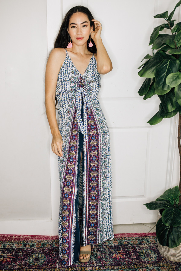 MAXI DRESS WITH SLIT, TIE FRONT DETAIL, AND ADJUSTABLE STRAPS. COMES IN BLUE AND RED. 55% COTTON, 45% RAYON.  SMALL 0-4 MEDIUM 6-10 LARGE 12-16