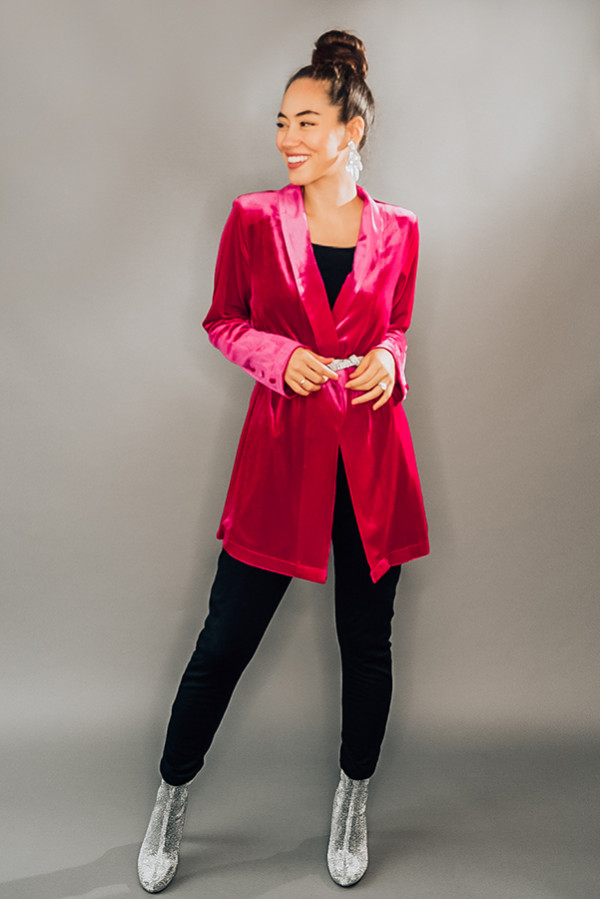 VELVET BLAZER. MAGENTA COLOR WITH BUTTON DETAIL ON SLEEVES. PIPER IS A SIZE 0 AND WEARING A SMALL. NIKI IS A SIZE 14 AND WEARING A L. 95% POLYESTER 5% SPANDEX  X-SMALL 0-2 SMALL 4-6 MEDIUM 8-10 LARGE 12-14 X-LARGE 16-18