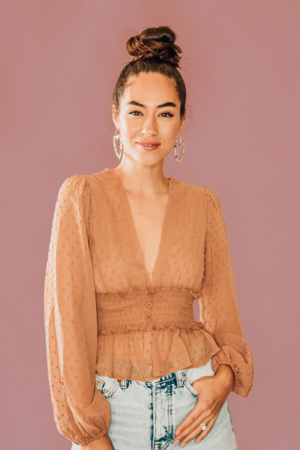 TAN, POLKA DOT, SHEER PLUNGE BLOUSE. CROPPED, RUFFLE BOTTOM, CINCHED SLEEVES, RUCHING, FAUX BUTTON MID SECTION. COMES IN TWO COLORS, TAN & BLACK. 100% POLYESTER. PIPER IS 5'4 SIZE 0, WEARING SMALL. STEPHANIE IS SIZE 4, WEARING SMALL. S 0-4 M 4-8 L 8-12