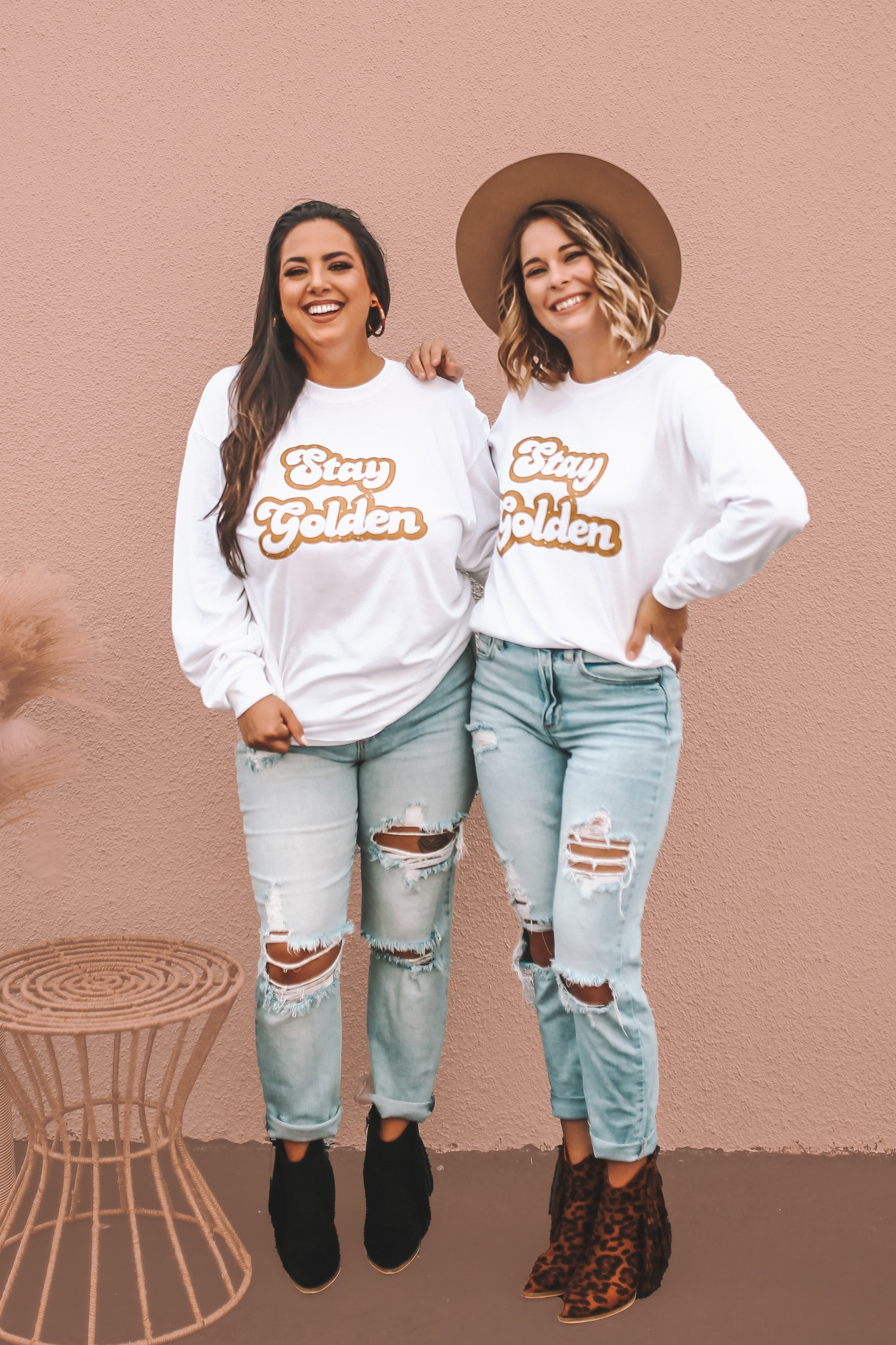 """MAVERICK EXCLUSIVE! WHITE UNISEX LONG SLEEVE TEE. GOLD """"STAY GOLDEN"""" GRAPHIC. 100% COTTON. AMANDA IS 5'7 SIZE 2, WEARING MEDIUM. GABBY IS 5'8"""" A SIZE 12 WEARING A LARGE FOR OVERSIZED LOOKS. S 0-4 M 4-8 L 8-12 XL 12-16 XXL 16-18"""