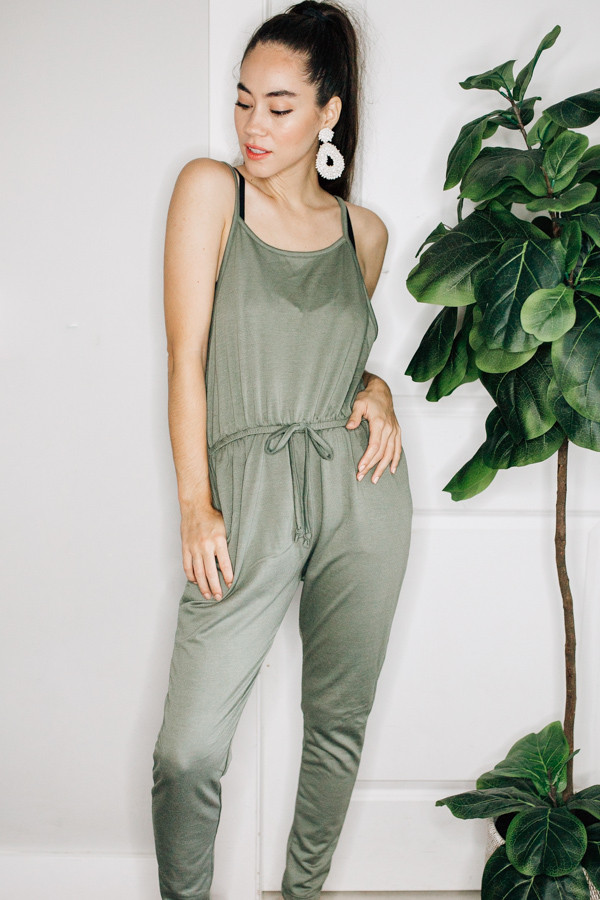 LIGHTWEIGHT, SOFT, FRENCH TERRY JUMPSUIT. COMES IN BLACK AND ARMY GREEN. 70% POLYESTER, 24% LINEN, 6% SPANDEX.  S 0-4 M 6-10 L 12-14
