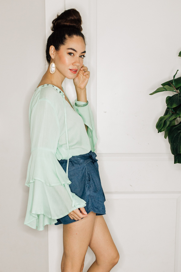 TOP WITH FLOWY, RUFFLED BELL SLEEVES. COMES IN APPLE GREEN AND PEACH. 100% POLYESTER.  SMALL 2-4 MEDIUM 8-8 LARGE 10-12