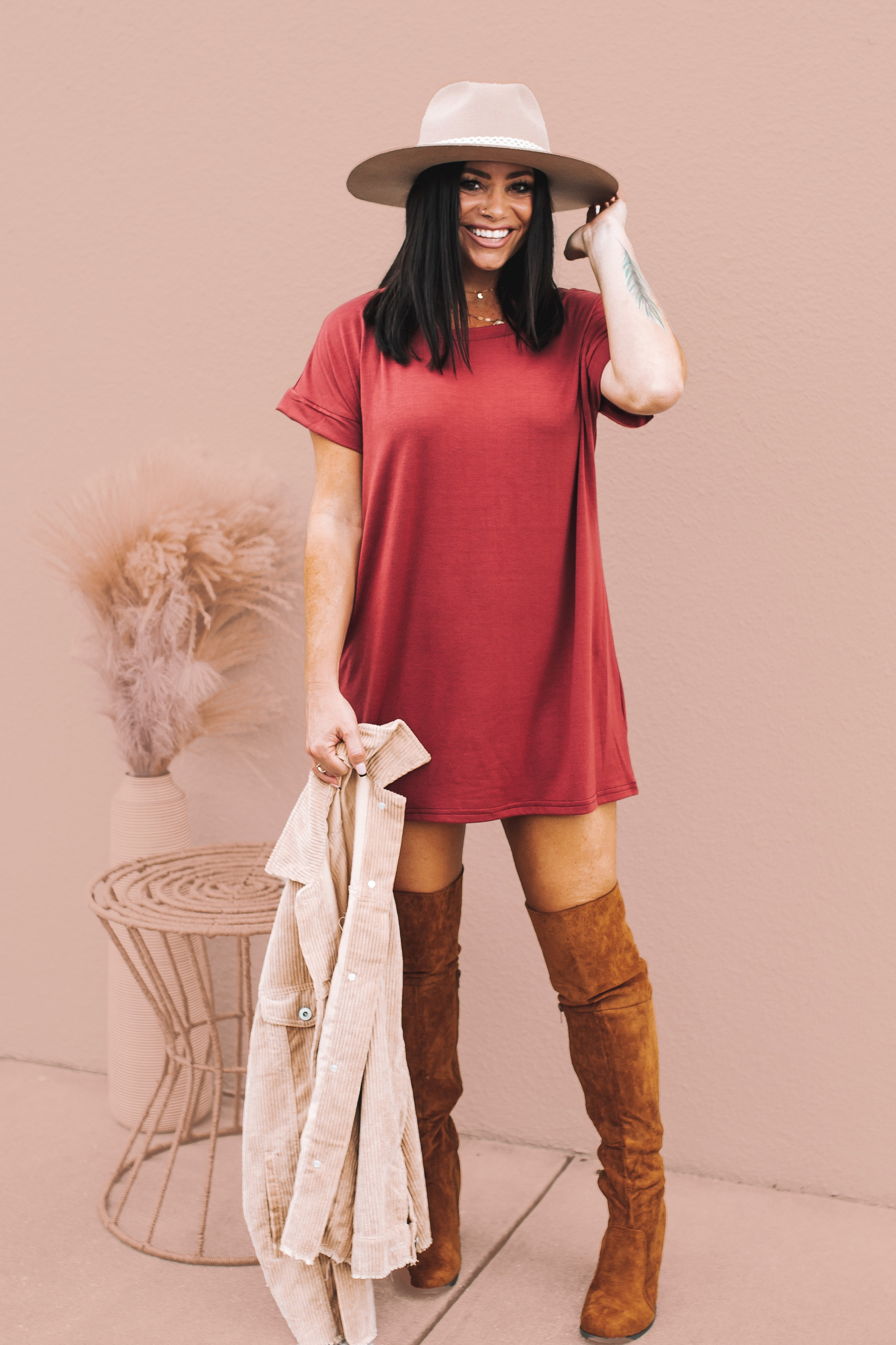 MAVERICK EXCLUSIVE! CRANBERRY TUNIC. DROP SHOULDER SHORT SLEEVES. SOFT, LIGHTWEIGHT FABRIC. 95% POLYESTER, 5% SPANDEX. AMANDA IS 5'7 SIZE 2, WEARING A SMALL. STEPHANIE IS SIZE 4 WEARING A SMALL. XS 0-2 S 4-6 M 8-10 L 10-12 XL 14-16