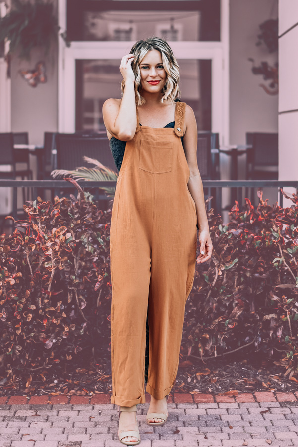 OVERSIZED BOHO LOOK, LIGHTWEIGHT CREPEY MATERIAL. STRAPS FEATURE EMBROIDERED OVERLAY WITH WOOD BUTTONS. POCKET ON FRONT AND FUNCTIONAL SIDE POCKETS. WIDE LEG WITH CUFFED BOTTOM. S 0-6 M 6-10 L 10-14 XL 14-16
