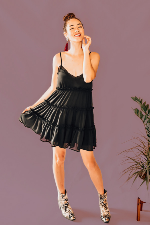 "BLACK TIERED BABYDOLL STYLE DRESS. RUFFLE V-NECK, ADJUSTABLE STRAPS, POCKETS, TIE BACK. 100% POLYESTER. PIPER IS 5'4"", SIZE 0, WEARING A SMALL. NIKI IS SIZE 14, WEARING AN XL. XS 0-2 S 4-6 M 8-10 L 12-14 XL 14-16"