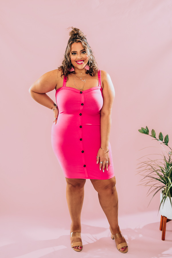HOT PINK, RIBBED BODYCON DRESS. BUTTON DOWN DETAIL AND HEART NECK. COMES IN THREE COLORS – BLACK, RUST, AND HOT PINK. 88% RAYON, 12% SPANDEX. PIPER IS 5'4 SIZE 0, WEARING A SMALL. NIKI IS SIZE 14, WEARING A LARGE.  S 0-4 M 6-10 L 12-16