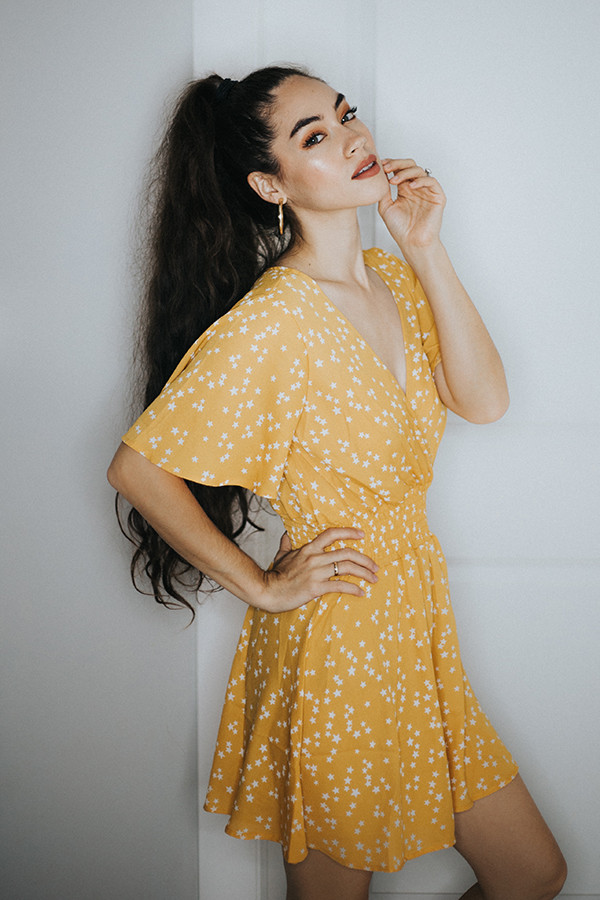 YELLOW STAR DRESS. V NECK AND AN ELASTIC WAIST ON THIS SHOW STOPPING DRESS. POLY BLEND.