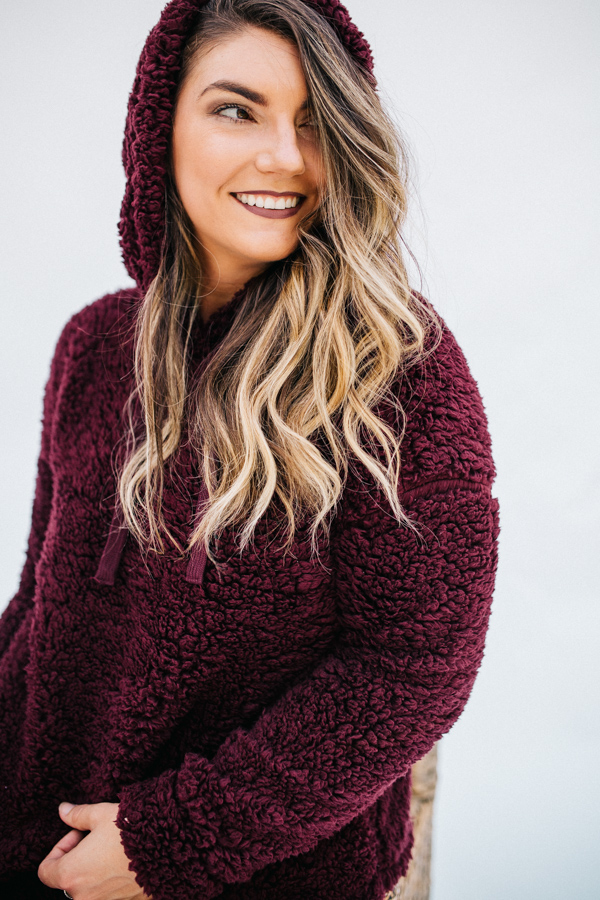 LONG SLEEVE FAUX FUR HOODIE TOP WITH DRAWSTRING. BURGUNDY COLOR. 100% POLYESTER.  SMALL 2/4 MEDIUM 6/8 LARGE 10/12 X-LARGE 14/16 1X 18 2X 20