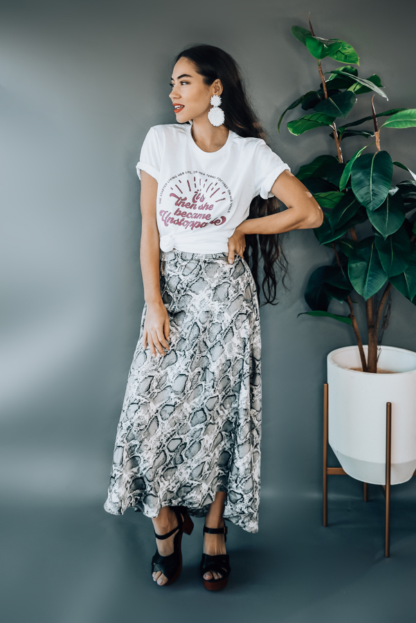 GREY, FLOWY SNAKE PRINT SATIN MIDI SKIRT WITH ELASTIC WAIST. MODEL INFO: PIPER IS SIZE 0 AND WEARING A SMALL, STEPHANIE IS A SIZE 4 WEARING A SMALL. RUNS BIG, BOTH WERE LOOSE  100% POLYESTER SMALL 2-8 MEDIUM 8-14 LARGE 14-16