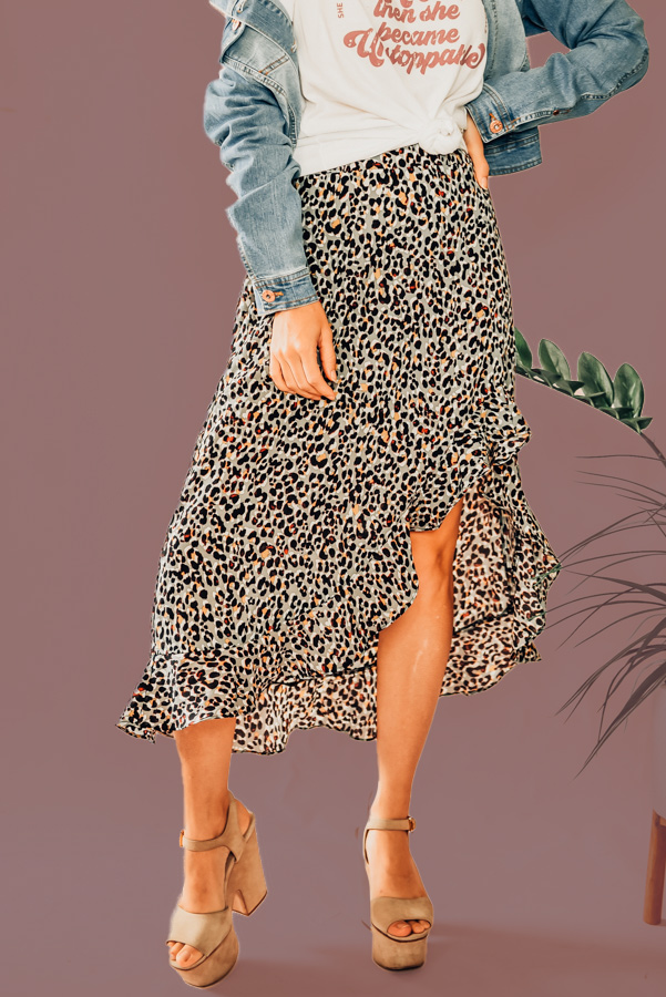 """GREY LEOPARD PRINT, MID LENGTH, SIDE SLIT, RUFFLE HEM SKIRT. ELASTIC ON WAIST TO MAKE FOR A COMFORTABLE FIT. 100% POLYESTER. PIPER IS 5'4"""", SIZE 0, WEARING A SMALL. NIKI IS SIZE 14, WEARING AN XLARGE. XS 0-2 S 4-6 M 8-10 L 10-12 XL 12-14"""
