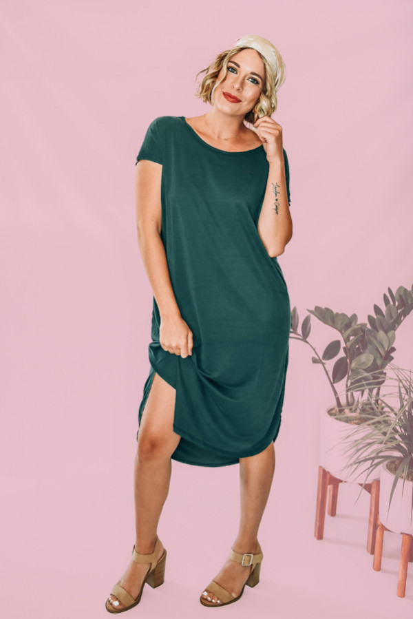 OVERSIZED AND FLOWY EMERALD GREEN, SUPER SOFT MODAL BLEND MATERIAL, BELOW KNEE LENGTH. CAP SLEEVES. 82% MODAL. 18% POLYESTER. AMANDA IS A SIZE 2, WEARING A SMALL. S 0-6 M 6-12 L 12-18