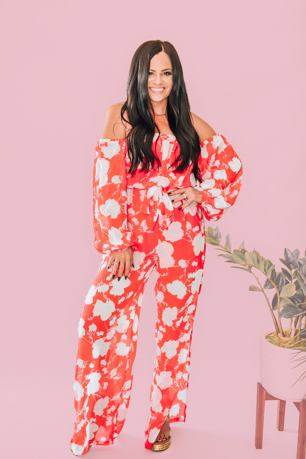 PANTSUIT JUMPER. SHEER SLEEVES AND LEGS. CAN BE WORN ON OR OFF SHOULDER. HALF ZIP KEYHOLE BACK. TIE AT WAIST. SLITS UP LEGS FOR A FLOWY LOOK. 100% POLYESTER. STEPHANIE IS 5'1 SIZE 4, WEARING A SMALL. S 0-4 M 4-8 L 8-12