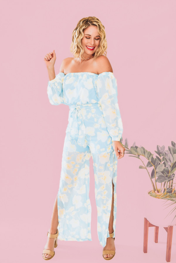 PANTSUIT JUMPER. SHEER SLEEVES AND LEGS. CAN BE WORK ON OR OFF SHOULDER. HALF ZIP KEYHOLE BACK. TIE AT WAIST. SLITS UP LEGS FOR A FLOWY LOOK. 100% POLYESTER. AMANDA IS 5'7 SIZE 2, WEARING A SMALL. S 0-4 M 4-8 L 8-12