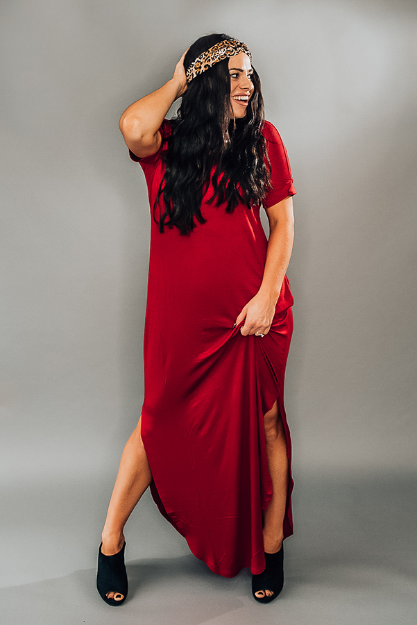 SHORT DOLMAN SLEEVE, DOUBLE V-NECK RED MAXI DRESS. FEATURES POCKETS AND SLIT AT SIDE. OVERSIZED DRESS. MODEL IS A SIZE 4 AND WEARING A SMALL, IT IS VERY OVERSIZED ON HER.  95% RAYON 5% SPANDEX  SMALL 10/12 MEDIUM 14/16 LARGE 18/20 X-LARGE 20/22