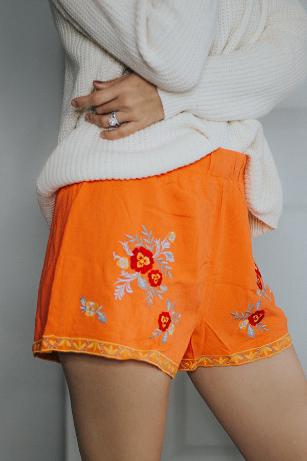 ORANGE SHORTS WITH FLORAL EMBROIDERY. ELASTIC WAIST.  100% RAYON SMALL 4-6   MEDIUM 8-10    LARGE 12-14