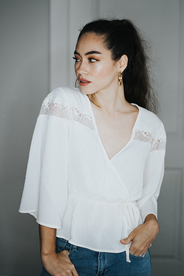 BOHO CREAM COLORED BLOUSE. BELL SLEEVES AND LACE DETAIL ON TOP. A TAD SHORTER IN THE WAIST.