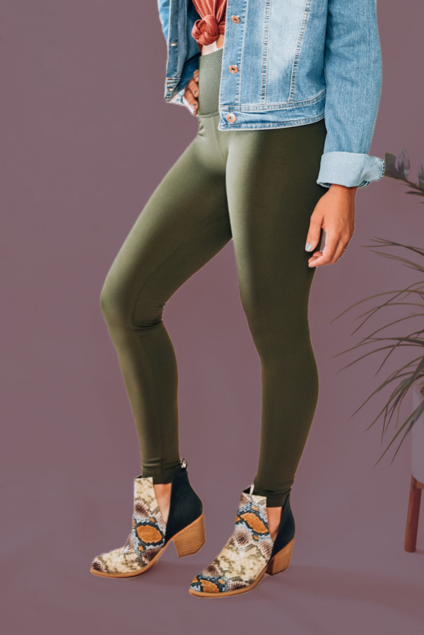"""OLIVE HIGH WAISTED LEGGINGS, THICK WAISTBAND. LINED WITH LIGHT FLEECE. 90% POLYESTER, 10% SPANDEX. TOTAL WAIST: 24"""", WAIST BAND: 5"""", INSEAM: 27"""" APPROX. - MEASURED FROM S/M. AMANDA IS 5'6"""" SIZE 2, WEARING A SML/MED.  SML/MED  0-6 LRG/XLG 6-12"""