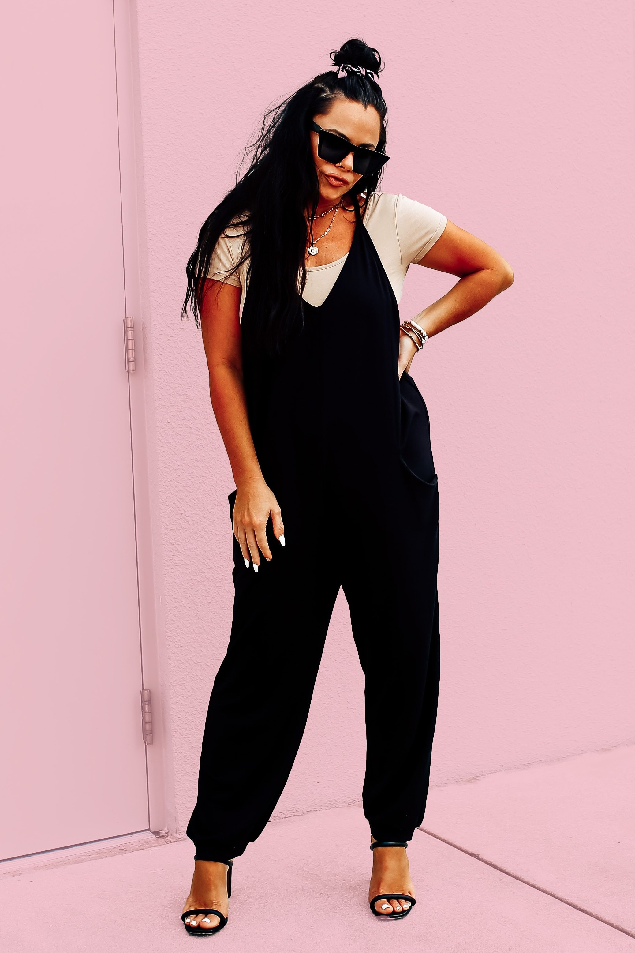 EXCLUSIVE TO MAVERICK! SLEEVELESS BLACK JUMPSUIT. OVERSIZED BOHO STYLE. V-NECK CUT, FUNCTIONAL SIDE POCKETS. LOOSE CUFFED ANKLE. VERY SOFT AND STRECHY. 95% POLYESTER, 5% SPANDEX.