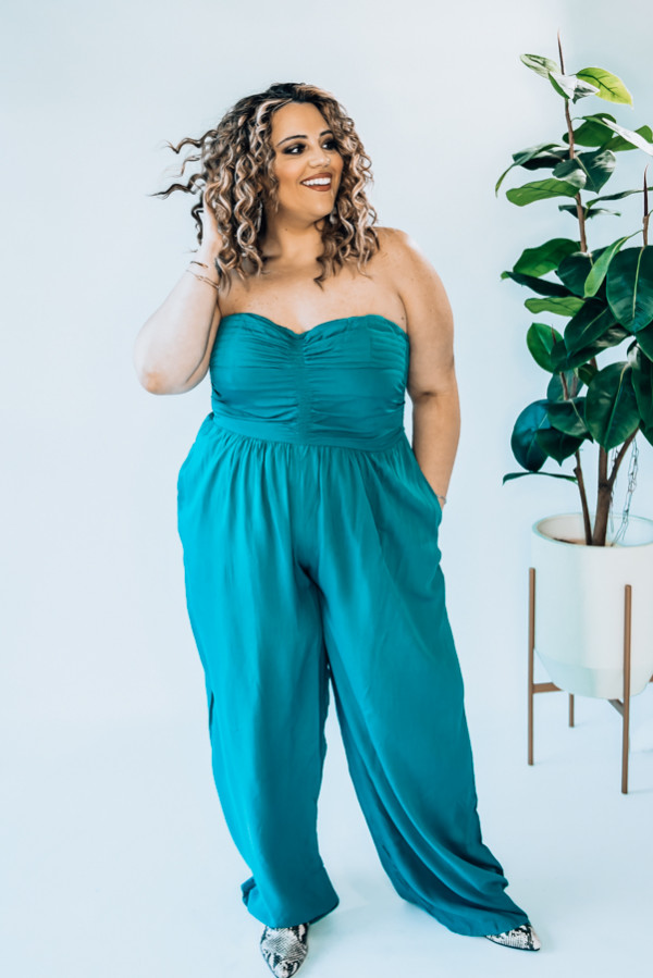 """TEAL, STRAPLESS JUMPSUIT. RUCHING DETAIL AND LINING AT TOP. MODEL INFO: STEPHANIE – SIZE 4, 5'1"""" WEARING A SMALL. NIKI – SIZE 14, 5'4"""", WEARING A LARGE.  X-SMALL 0-2 SMALL 4-6 MEDIUM 6-8 LARGE 10-12 X-LARGE 12-14"""