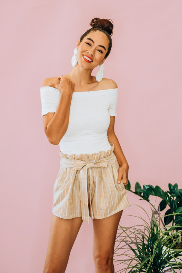 WHITE, SMOCKED SHORT SLEEVE SPANDEX TOP. OFF THE SHOULDER. COMES IN THREE COLORS – BLACK, WHITE, AND MUSTARD. 95% RAYON, 5% SPANDEX. PIPER IS 5'4 SIZE 0, WEARING SMALL.  S 0-4  M 6-10 L 10-14
