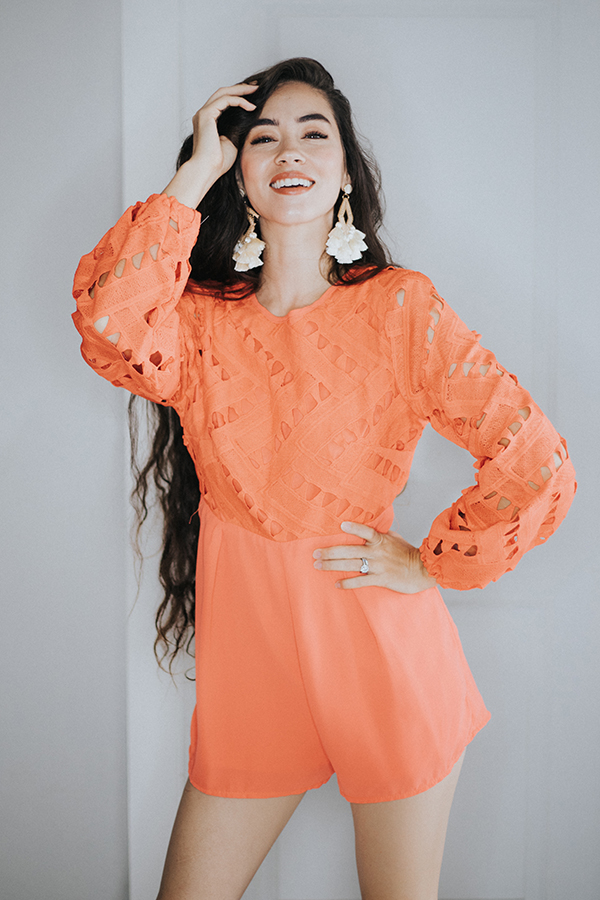 CORAL LONG SLEEVE ROMPER. KEYHOLE BACK DESIGN.  CUT OUT DESIGN ON BODICE/SLEEVE.  100% POLYESTER SMALL 4-6   MEDIUM 8-10    LARGE 12-14