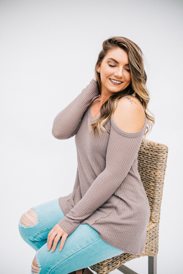 LONG SLEEVE, WAFFLE KNIT COLD SHOULDER TOP.  ASYMMETRICAL HEMLINE. TAUPE COLOR. ALSO COMES IN ROSE. 60% POLYESTER 35% COTTON 5% SPANDEX SMALL 0-4  MEDIUM 6-10   LARGE 12-15