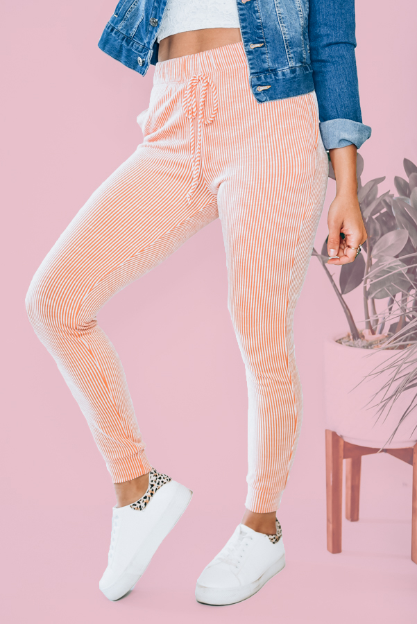 MADE IN USA. JOGGER STYLE. VERY SOFT. ELASTIC WAIST AND CUFF, CORAL AND WHITE STRIPED.  AMANDA IS 5'7 SIZE 2, WEARING A SMALL.  XS 0-2 S 4-6 M 8-10 L 10-12 XL 12-14