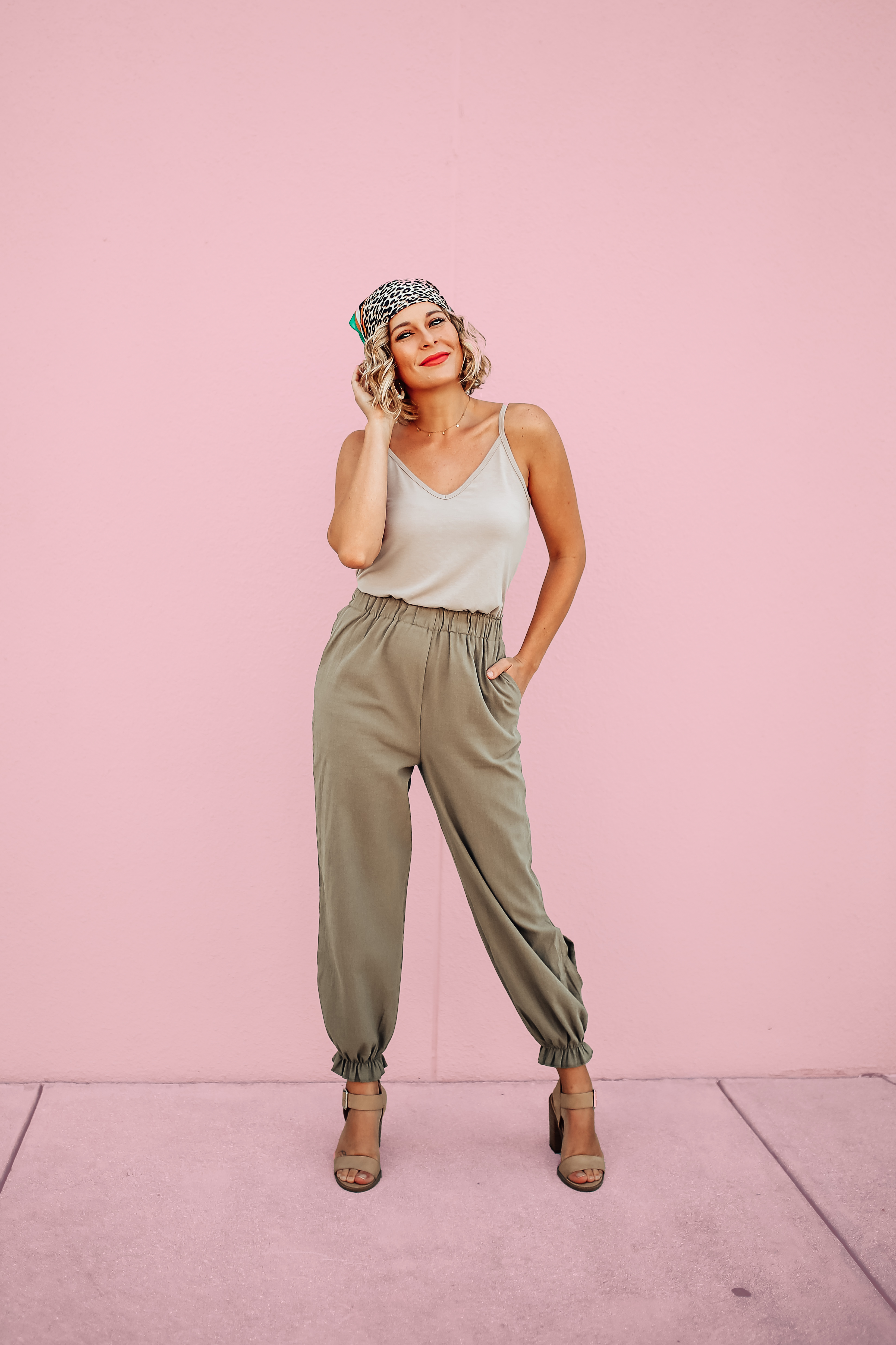 """LIGHTWEIGHT PAPERBAG PANTS. ELASTIC WAIST AND ANKLES. FUNCTIONAL SIDE POCKETS. KEYHOLE DETAIL ON BOTTOM OF BOTH SIDES. 100% COTTON. GABBY IS 5'8"""" A SIZE 10/12 AND 38DD WEARING A LARGE. S 0-4 M 4-8 L 10-12"""