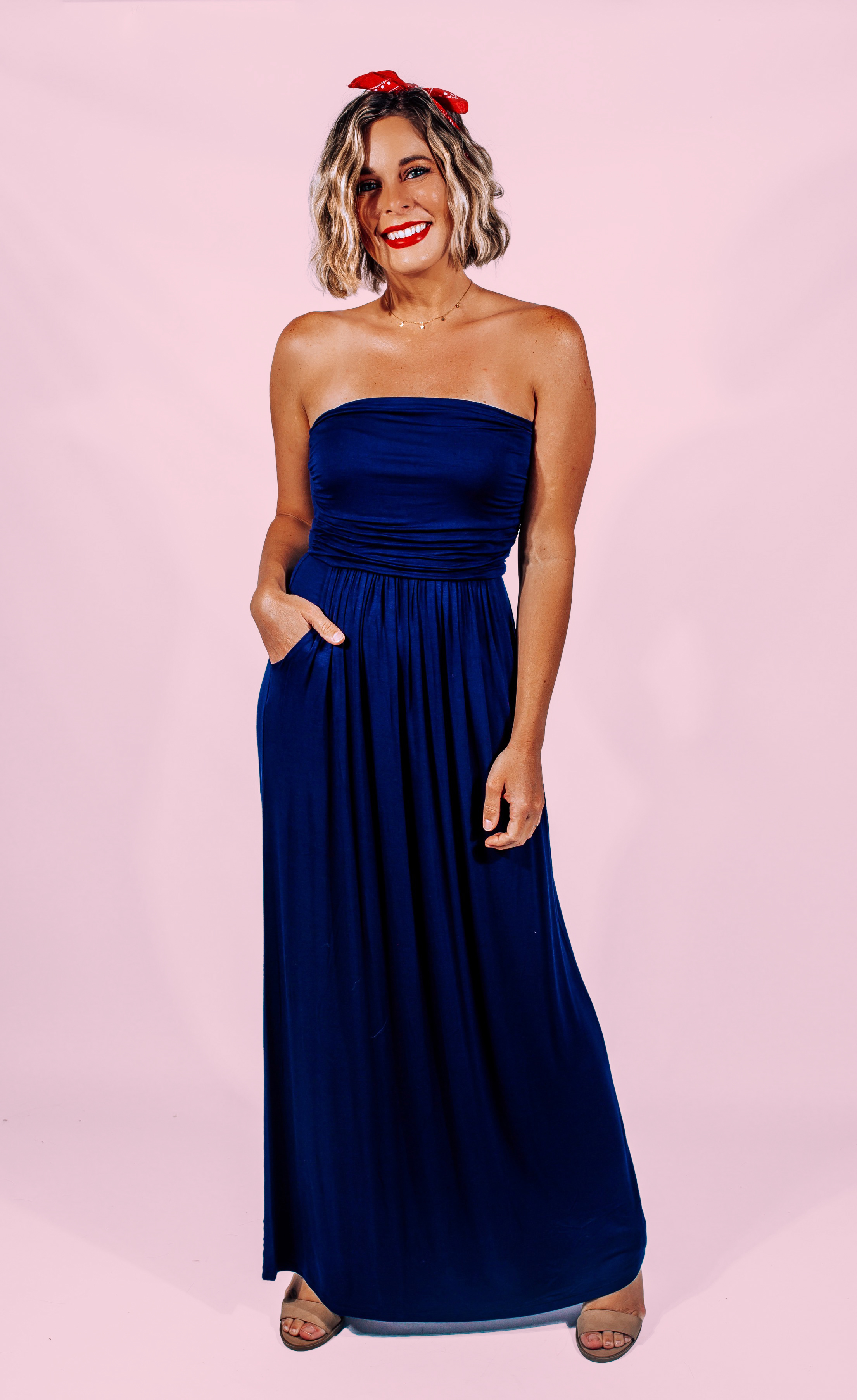 """NAVY TUBE TOP MAXI DRESS WITH POCKETS. 94% RAYON MODAL, 6% SPANDEX. AMANDA IS 5'7"""" A SIZE 2, WEARING A SMALL. FRANCELINE IS A SIZE 16, BUST 40, WEARING A LARGE. DALLAN IS 5'7"""" SIZE 4/6 WEARING A SMALL.  S 0-6 M 6-12 L 12-18"""