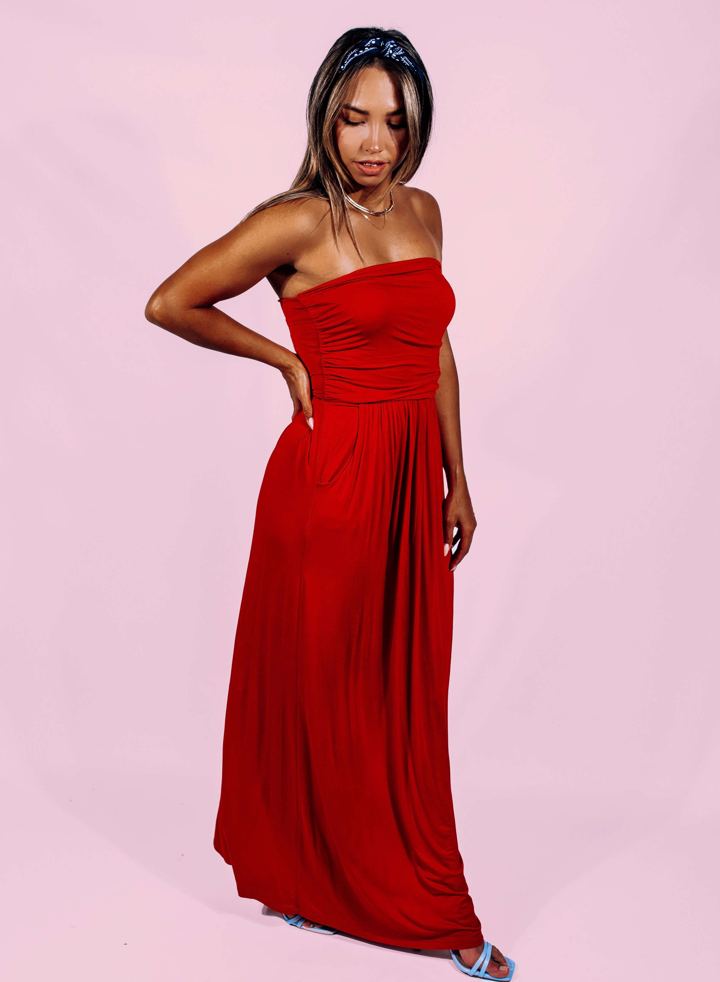 """RED TUBE TOP MAXI DRESS WITH POCKETS. 94% RAYON MODAL, 6% SPANDEX. AMANDA IS 5'7"""" A SIZE 2, WEARING A SMALL. FRANCELINE IS A SIZE 16, BUST 40, WEARING A LARGE. DALLAN IS 5'7"""" SIZE 4/6 WEARING A SMALL. S 0-6 M 6-12 L 12-18"""