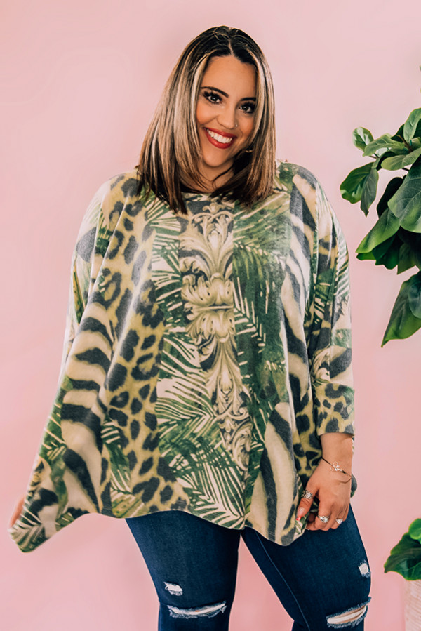 "ABTRACT ANIMAL PRINT PONCHO TOP. LOOSE, FLOWY FIT FEATURING ROUND NECKLINE AND 3/4 SLEEVES. MODEL INFO: PIPER – SIZE 0, 5'5"" WEARING A SMALL. NIKI – SIZE 14, 5'4"", WEARING A LARGE. 68% POLYESTER, 29% RAYON, 3% SPANDEX SMALL 0 -6  MEDIUM 8-12 LARGE 14-18"