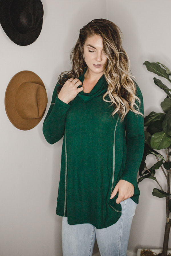 GREEN COWL NECK TOP WITH LIGHT FLEECE TETURE. LONGER AND FLOWY. 65% POLYESTER, 32% RAYON, 3% SPANDEX.  SMALL 0-4 MEDIUM 4-8 LARGE 8-12 X-LARGE 12-14