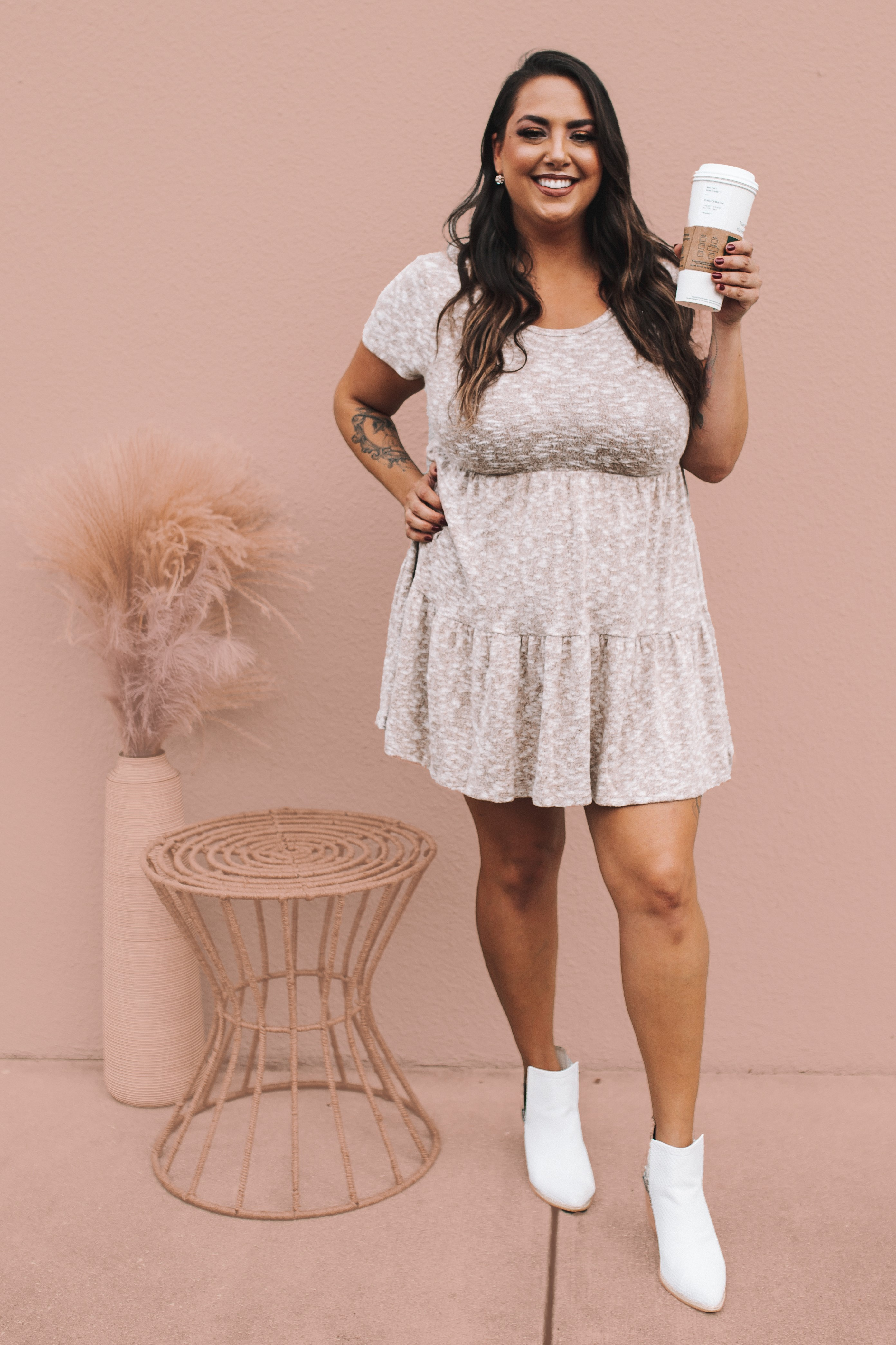 MAVERICK EXCLUSIVE! BROWN AND WHITE HEATHERED, SHORT SLEEVE BABYDOLL DRESS. SUPER SOFT AND STRETCHY. LIGHTWEIGHT AND FLOWY KNIT. 52% COTTON,  44% POLYESTER, 4% SPANDEX.