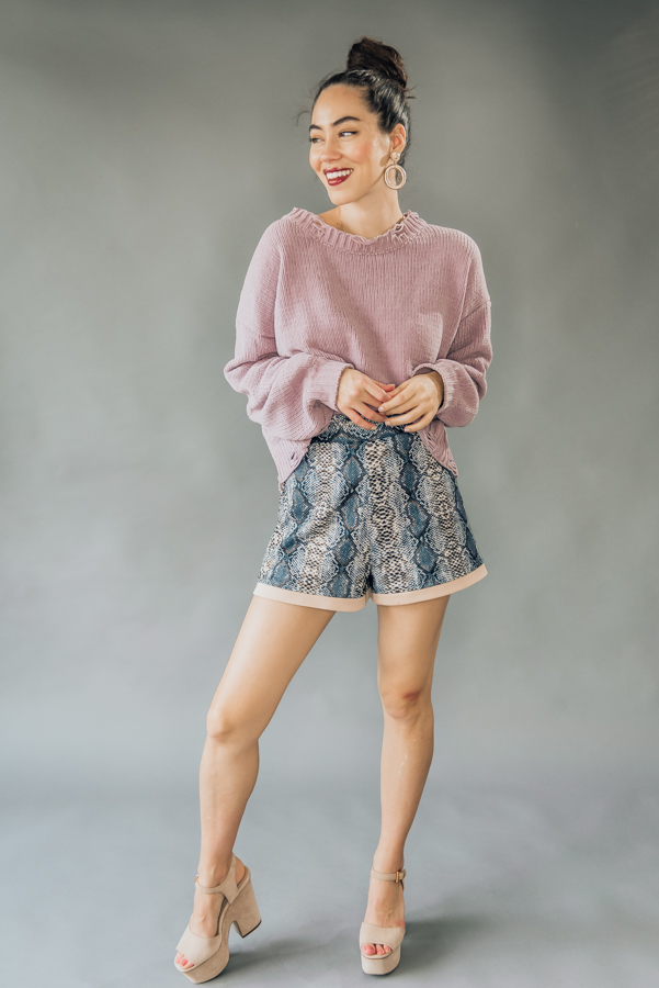 """CHARCOAL SNAKE PRINT SHORTS WITH TAN DETAIL AT BOTTOM. HIGH WAISTED AND FULLY LINED. MODEL INFO: PIPER - SIZE 0, 5'5"""", WEARING A SMALL, FIT WAS LOOSE. 100% POLYESTER SMALL 2-6 MEDIUM 8-10 LARGE 10-12"""